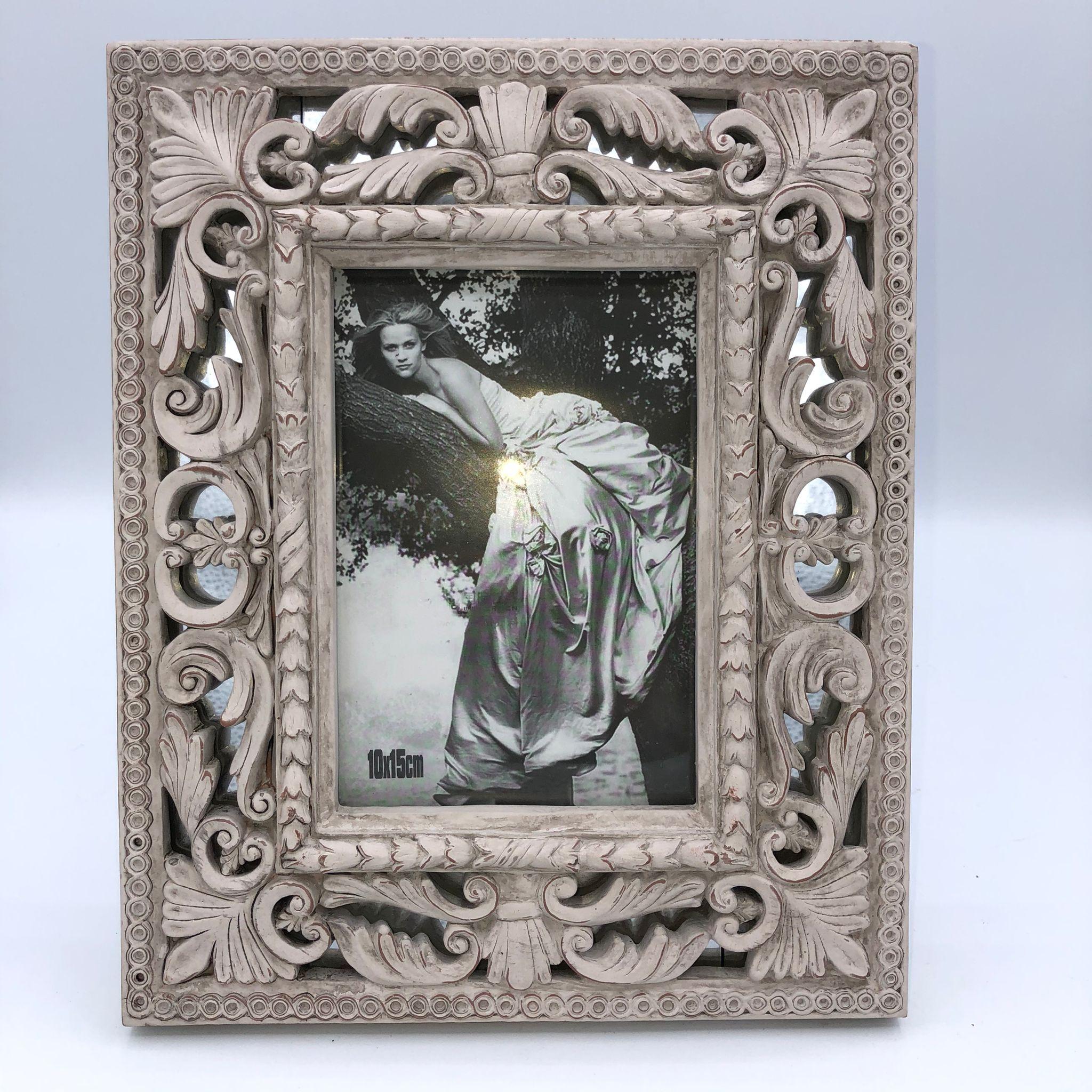 Marco de fotos madera tallada