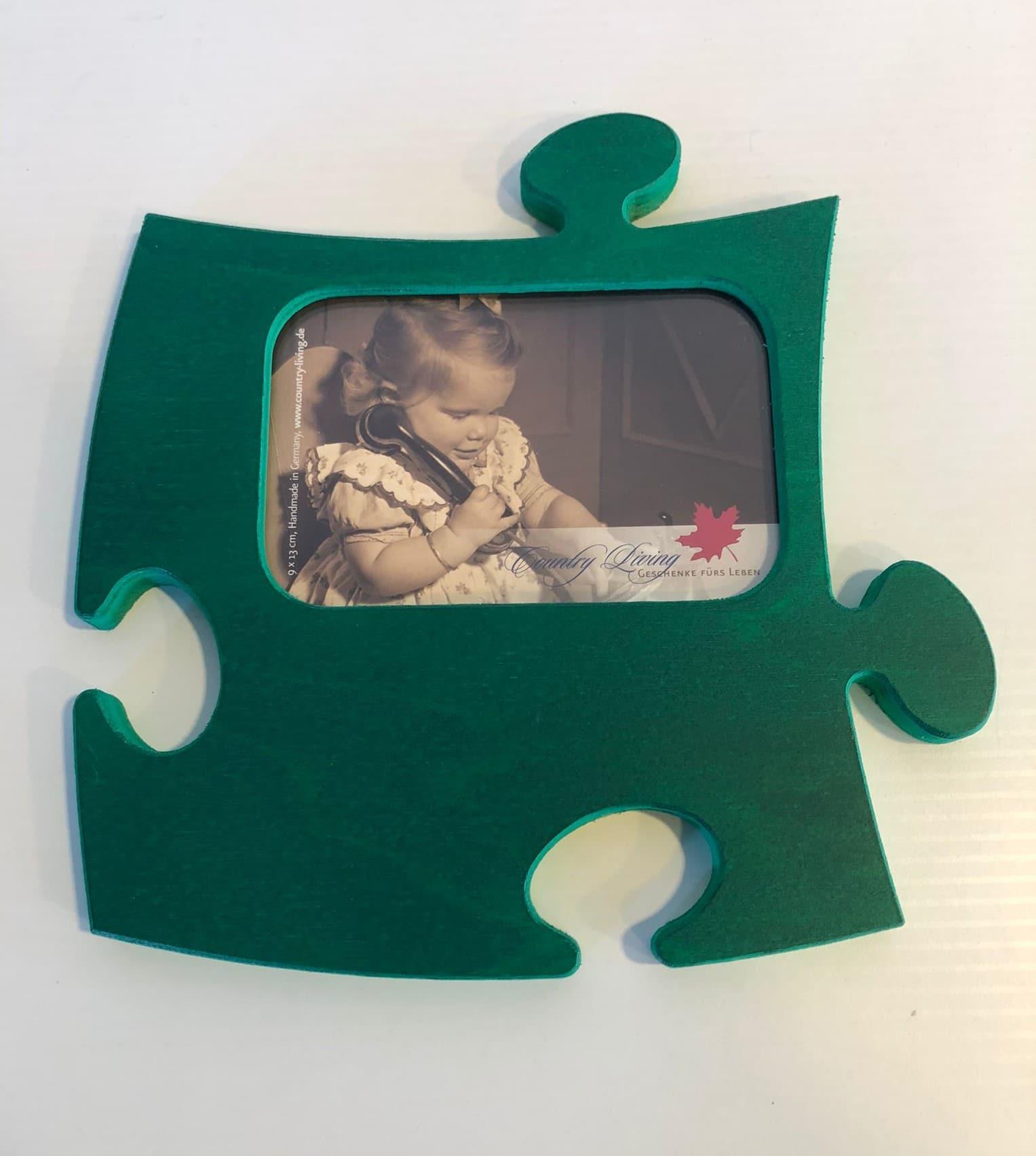Marco de fotos en forma de puzzle